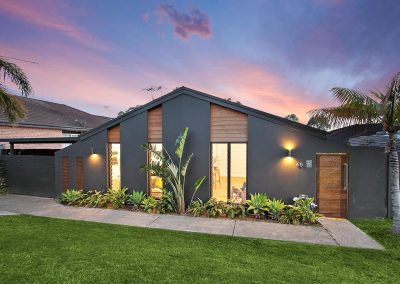 Modern Charcoal Home Exterior With Beautiful Large Panel Windows - Home Renovations Illawarra - Builders Illawarra