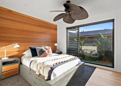 Newly Renovated Bedroom, Timber Feature Wall & Oversized Window - Home Renovations Illawarra - Builders Illawarra