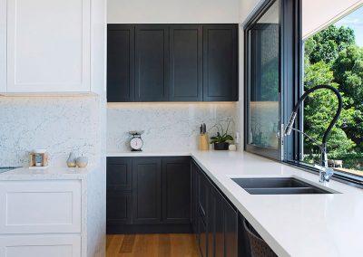 Modern White Kitchen Offset With A Stylish Dark Grey - New Home Builders Illawarra - Builders Illawarra