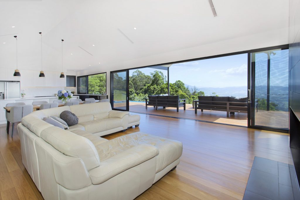 Stunning & Modern Open Plan Lounge Room Looking Out To A Beautiful Alfresco Deck Area – New Home Builders Illawarra – Builders Illawarra