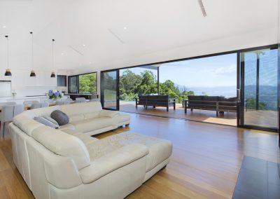 Stunning & Modern Open Plan Lounge Room Looking Out To A Beautiful Alfresco Deck Area - New Home Builders Illawarra - Builders Illawarra