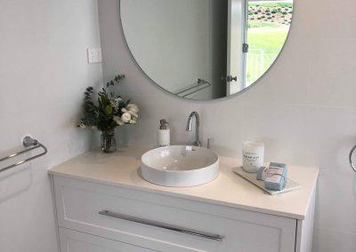 Modern Round Bathroom Sink & Large Round Mirror In New Bathroom - Builders Illawarra