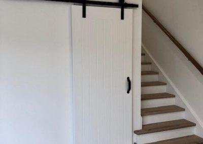 Luxurious Hanging Bathroom Door Closed - Builders Illawarra