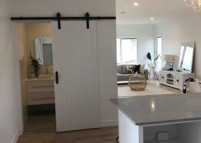 Luxurious Hanging Bathroom Door Open - Builders Illawarra