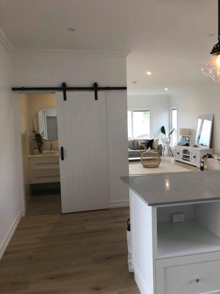 Luxurious Hanging Bathroom Door Open – Builders Illawarra